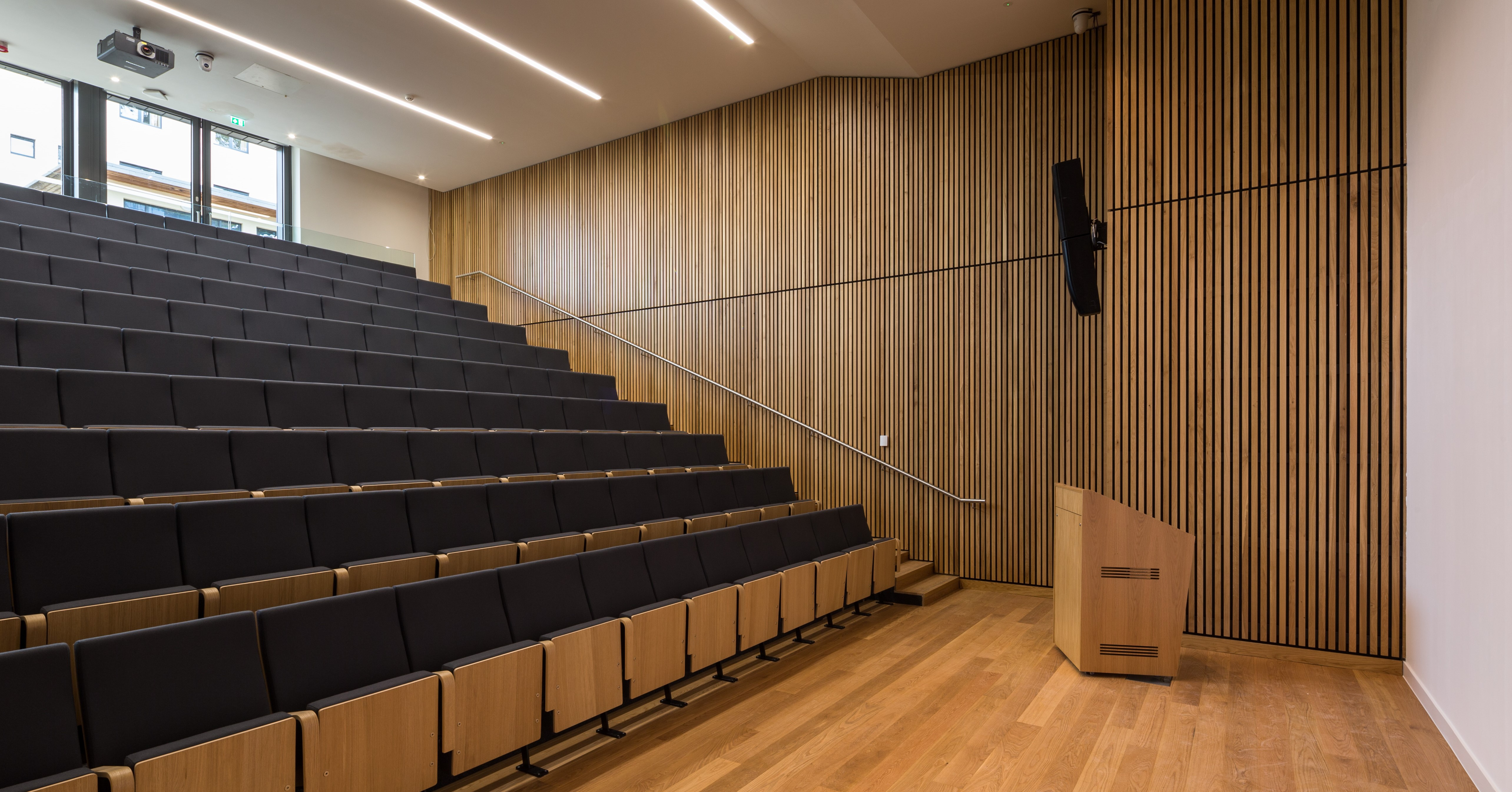 An auditorium with tiered seating.