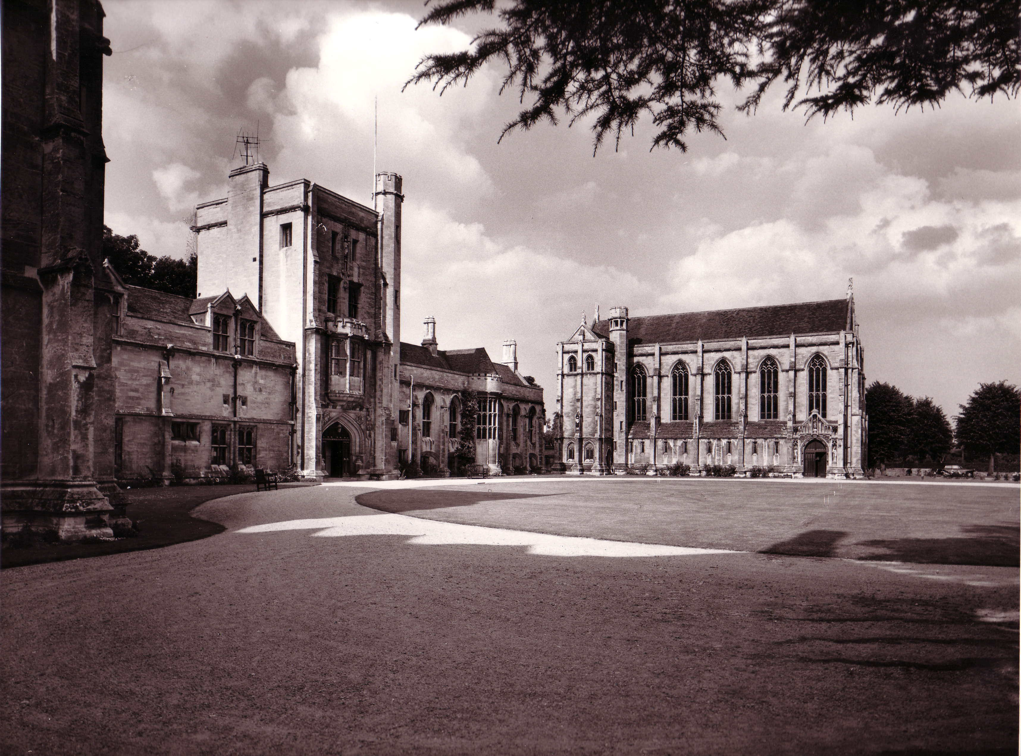 A monochrome photograph of the Mansfield quad in the early 20th century. The photo is taken from outside the Principal's Lodging, facing across the quad towards the Chapel and the Main Building.