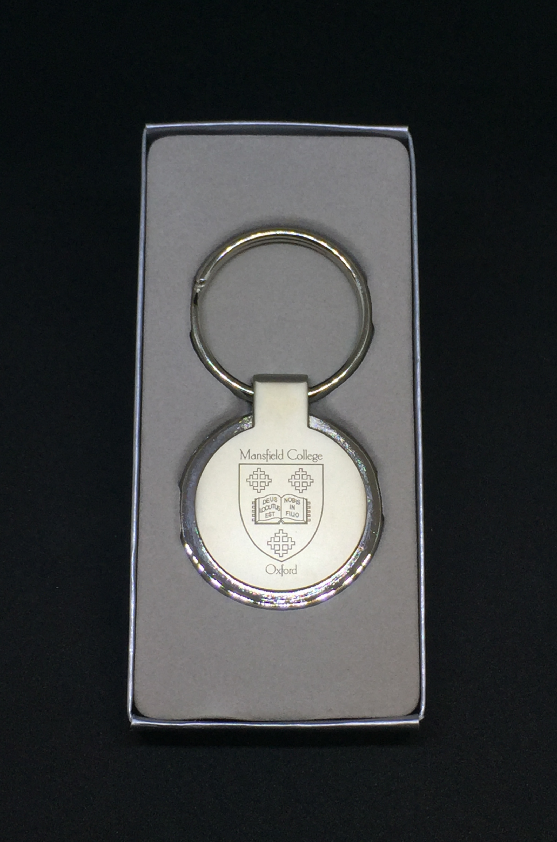 The engraved keyring is shown in a presentation box.