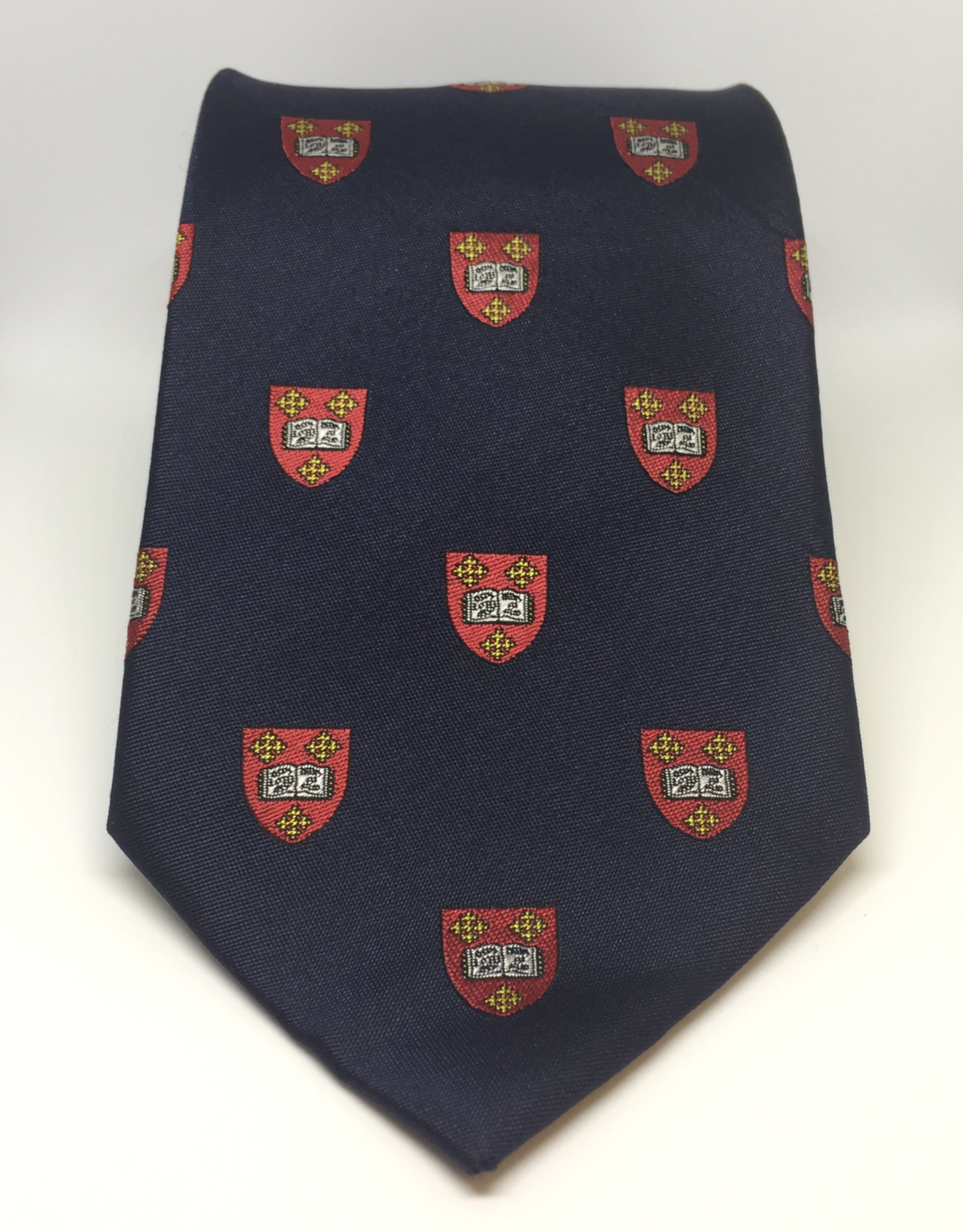 a Mansfield College silk tie with repeat crest pattern.