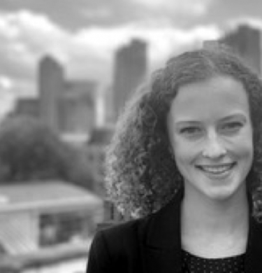 Headshot of Danielle Buckett with the city of London in the background.