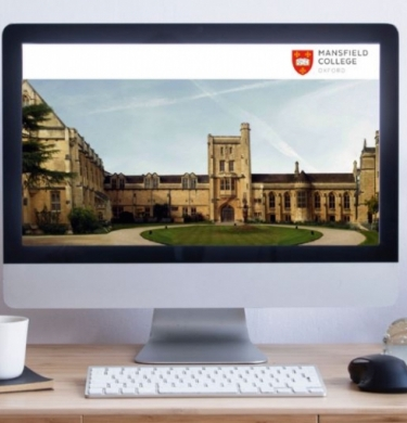 Computer screen and desk showing Mansfield website