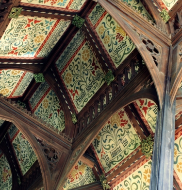 Links to the 'Student Handbook' page and shows the ornate library ceiling