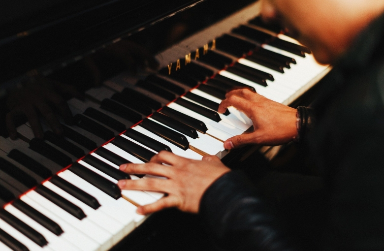 Person playing a piano