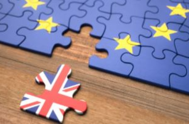 Puzzle featuring EU flag with a piece missing. That puzzle piece also appears and features a Union Jack.
